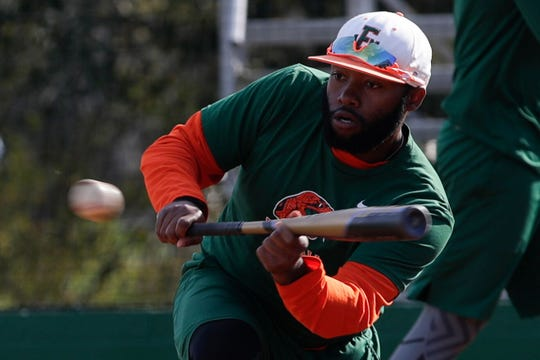 FAMU outfielder William Brooks lays down a perfect bunt in practice. The former Godby High School star looks to help the Rattlers begin the 2019 season on a high note in the Andre Dawson Classic Feb. 15-17 in New Orleans