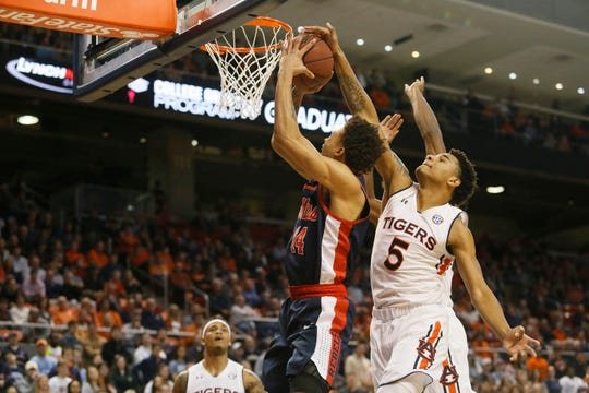 forward Chuma Okeke (5) blocks the shot of Ole Miss forward KJ Buffen (15) on Feb. 13, 2019, in Auburn, Ala.