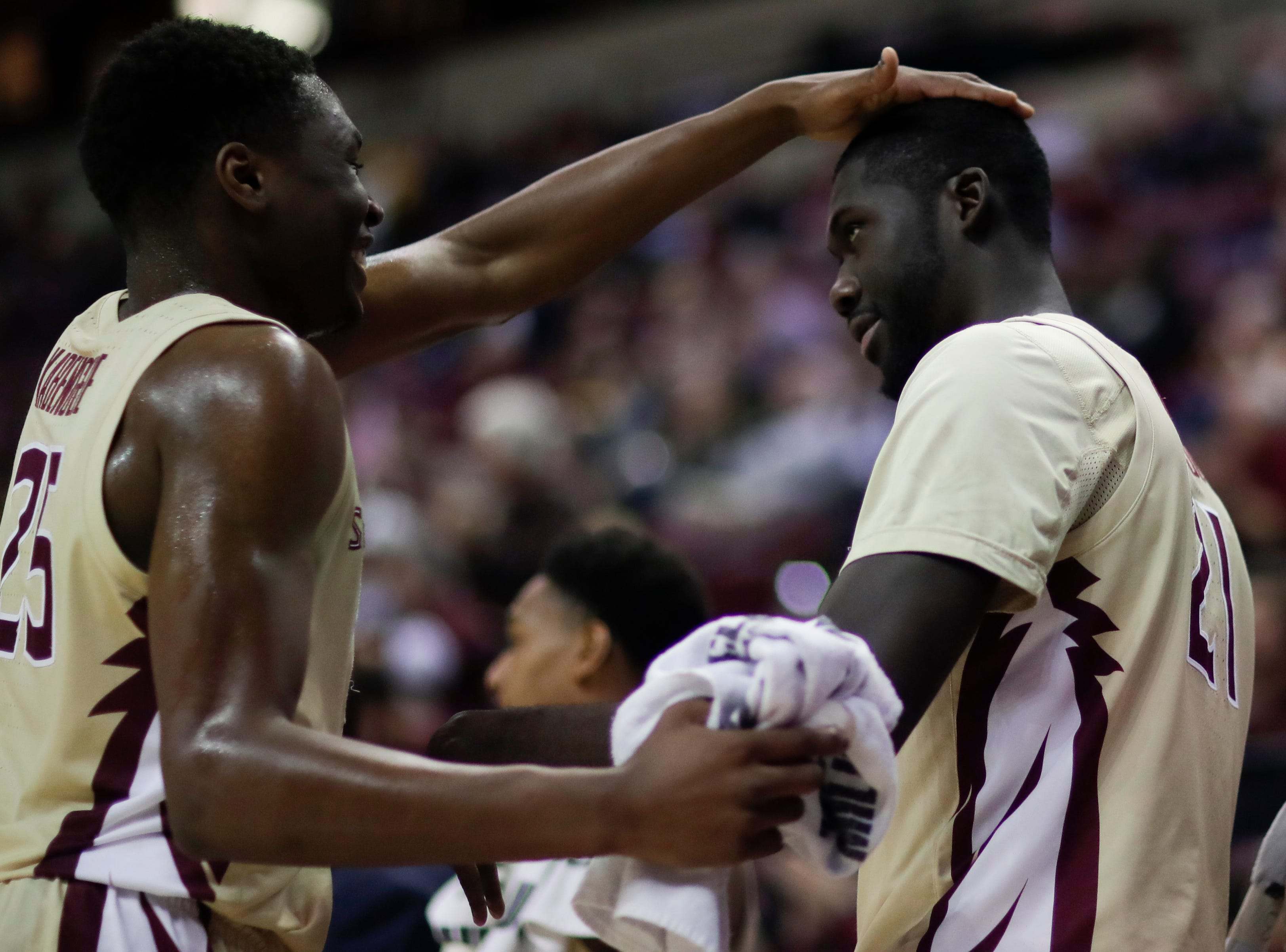 Florida State Seminoles forward Mfiondu Kabengele (25) taps Florida State Seminoles center Christ Koumadje (21) on the head after Koumadje finishes the game with his first career double double during a game between FSU and Wake Forest at the Donald L. Tucker Civic Center Wednesday, Feb. 13, 2019.