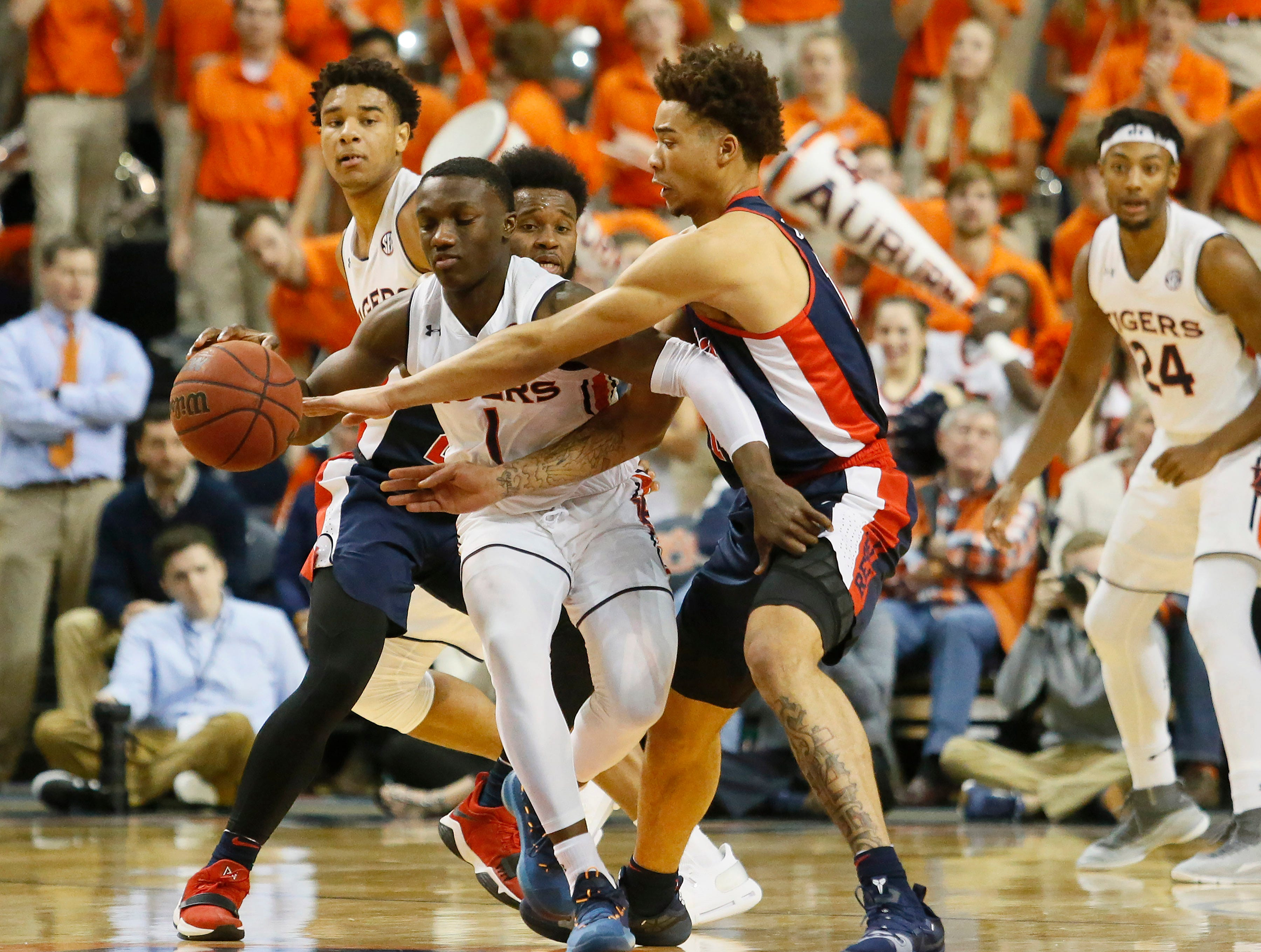 Feb 13, 2019; Auburn, AL, USA; Ole Miss Rebels forward KJ Buffen (14) tries to steal the ball from Auburn Tigers guard Jared Harper (1) during the first half at Auburn Arena. Mandatory Credit: John Reed-USA TODAY Sports