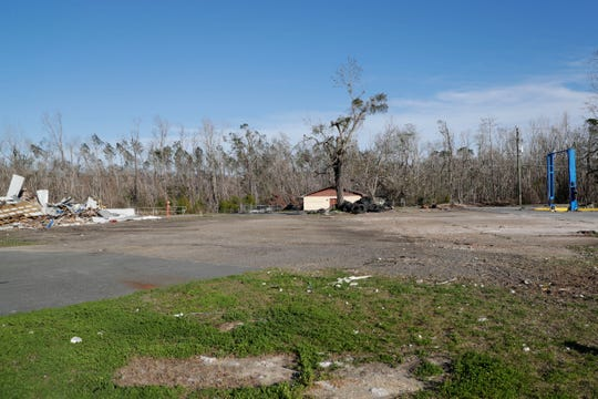 Debris remains on the land where the Mallory Towing business once was, Wednesday Feb. 13, 2019. The building was flattened by Hurricane Michael in Oct. 2018.