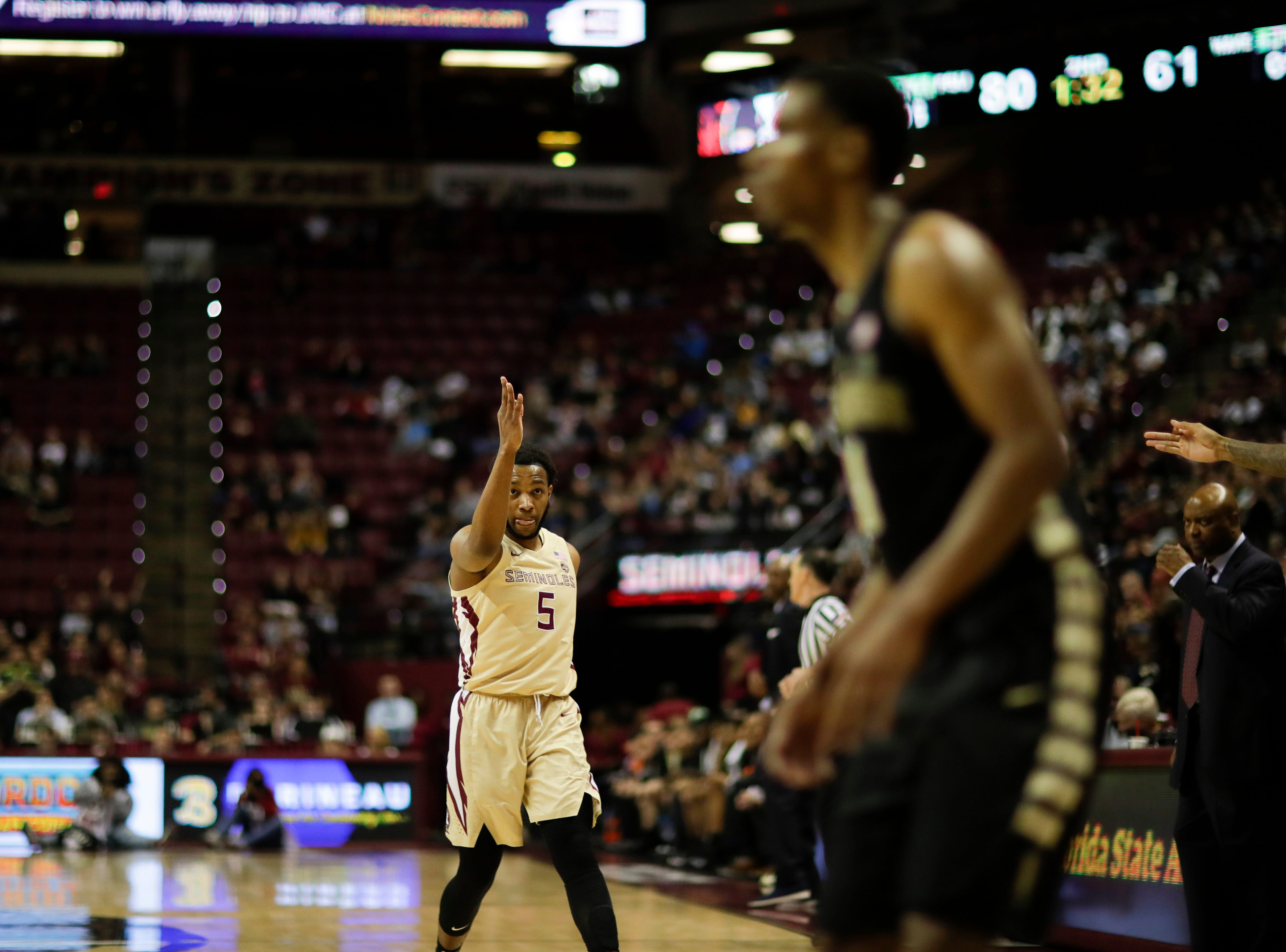 """Florida State Seminoles guard PJ Savoy (5) does """"the chop"""" after scoring during a game between FSU and Wake Forest at the Donald L. Tucker Civic Center Wednesday, Feb. 13, 2019."""