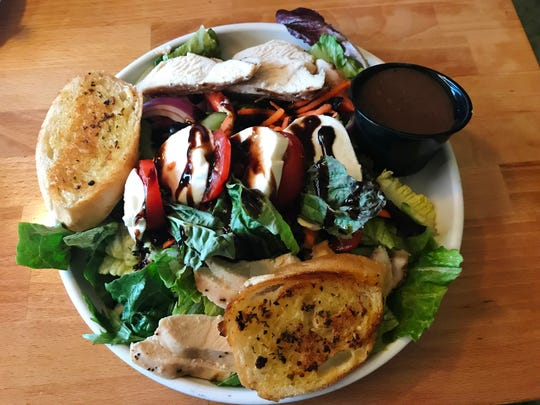 The Cottage Grill caprese salad was fresh greens topped with creamy buffalo mozzarella with bright red slices of tomato alongside grilled slices of chicken.