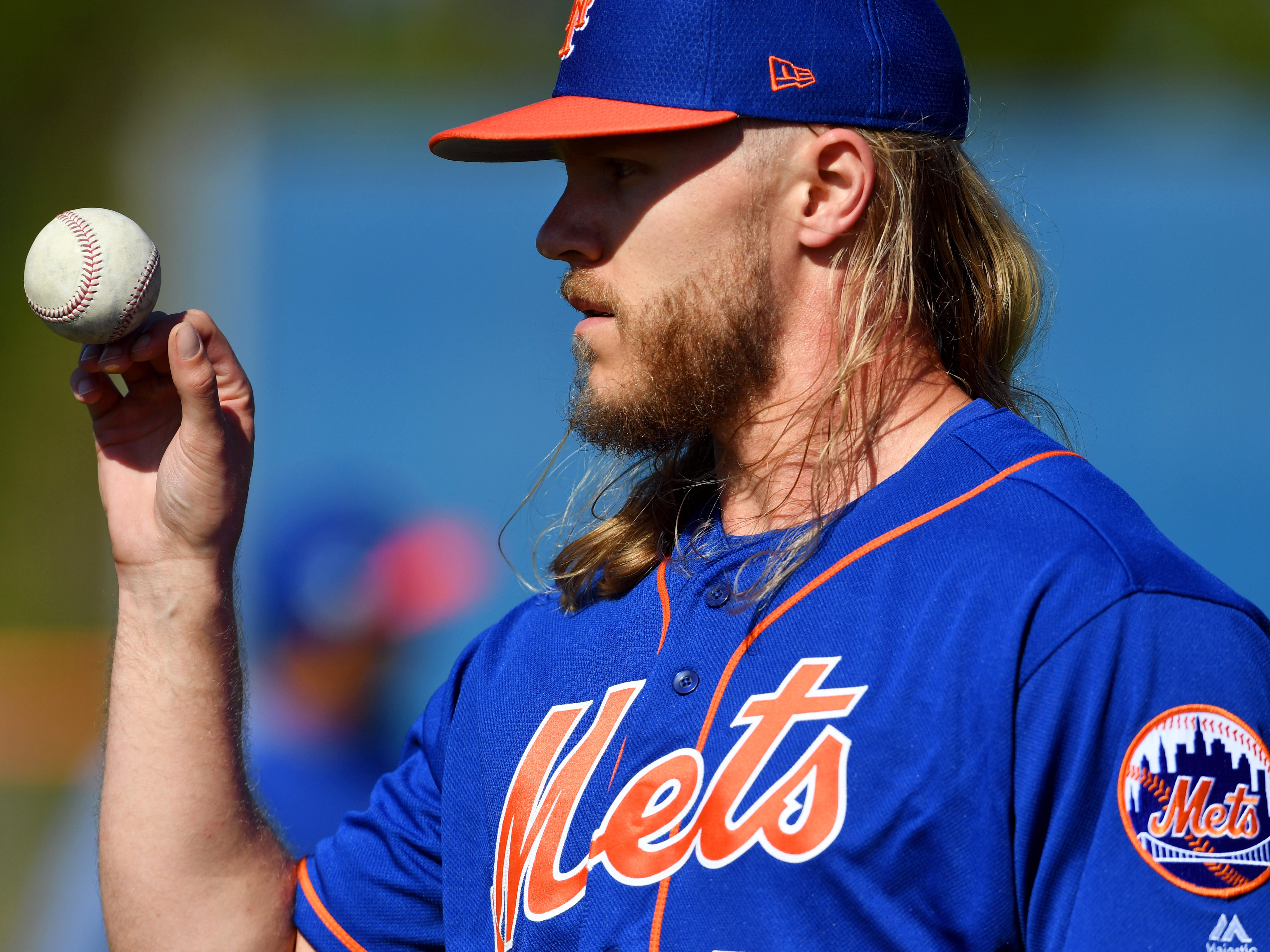 New York Mets right-handed pitcher Noah Syndergaard walks off the field on Thursday, Feb. 14, 2019 during morning workouts for pitchers and catchers at First Data Field in Port St. Lucie.