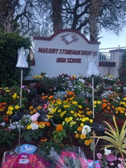 "Flowers, candles and kindness stones at Marjory Stoneman Douglas High School for ""Project Grow Love,"" a memorial garden created by students, teachers and staff."