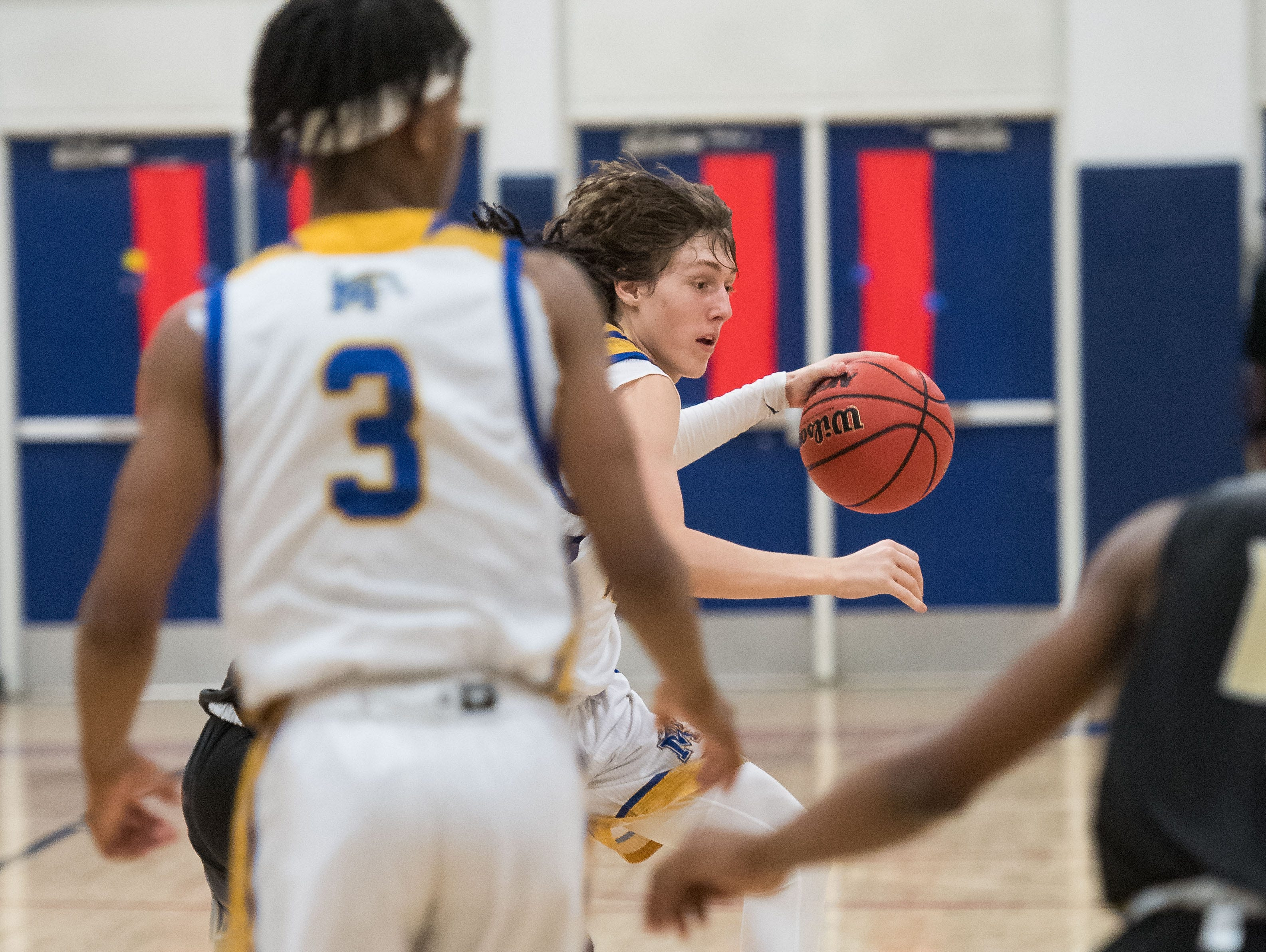 Martin County plays against Treasure Coast during the high school boys basketball District 8-9A tournament game Wednesday, Feb. 13, 2019, at St. Lucie West Centennial High School in Port St. Lucie.