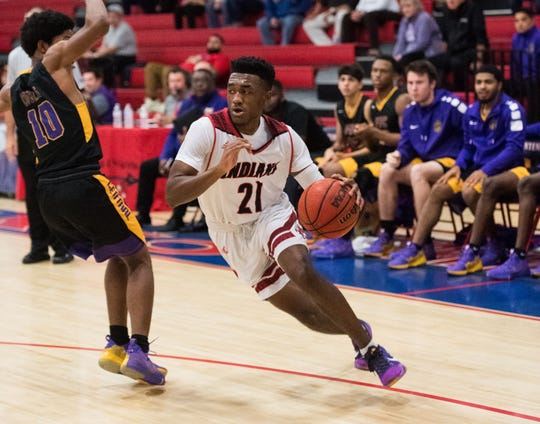 Vero Beach senior Javien Cuff drives toward the basket in the District 8-9A semifinal against Fort Pierce Central on Feb. 13, 2019.
