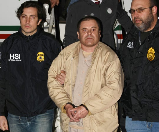 "In this Jan. 19, 2017, photo provided by the U.S. Drug Enforcement Administration, authorities escort Joaquin ""El Chapo"" Guzman, center, from a plane to a waiting caravan of SUVs at Long Island MacArthur Airport in Ronkonkoma, N.Y. The notorious Mexican drug lord was convicted of drug-trafficking charges, Tuesday, Feb. 12 2019, in federal court in New York."