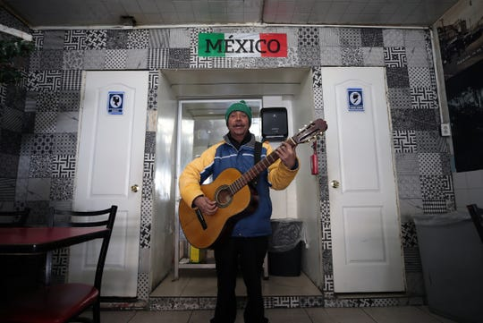 A musician performs after strolling into El Taquito Mexicano in Ciudad Juárez. Street musicians and Juarenses, in general, have returned to the streets of Juarez after years of fear over cartel killings in the city.