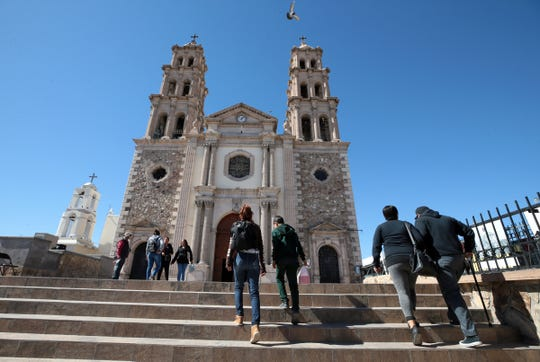 Juarenses are out and about in the border city after years of cartel killings. Above, families climb the stairs to visit the Catedral de Nuestra Senora de Guadalupe, the centerpiece of downtown Juarez.