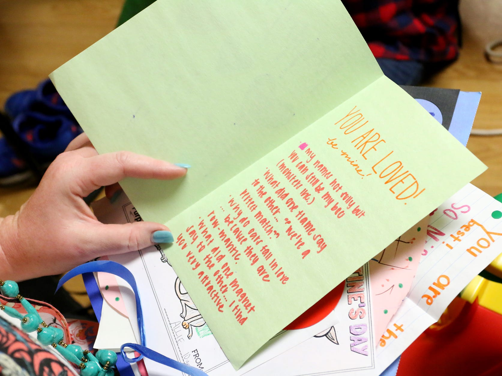 Amber Twomey reads the Valentine's Day cards that were given to her son at the Prisma Health Children's Hospital.