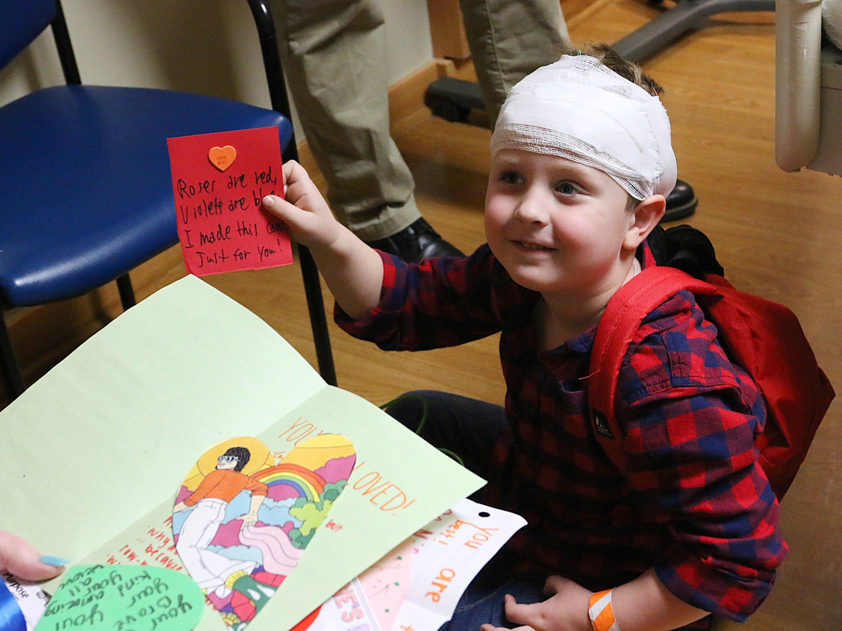 Connor holds up one of the several homemeade Valentine's Day cards he received on Thursday morning at the Prisma Health Children's Hospital.