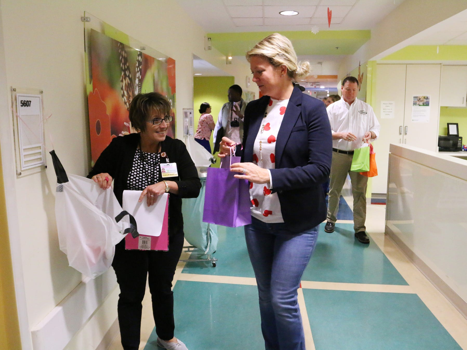 Melissa Long helps deliver Valentine's Day cards that were made for the children at the Prisma Health Children's Hospital.