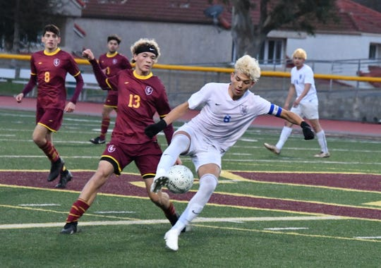 Simi Valley striker Jared Fuller closes down Alta Loma's Caleb Strickland on Wednesday night in the CIF-Southern Section Division 2 quarterfinals at Simi Valley High. Alta Loma won, 1-0.