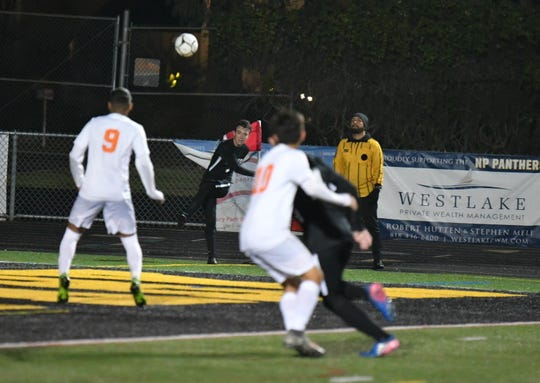 Luke Varav curls in Newbury Park's first goal from a corner kick in Wednesday night's CIF-Southern Section Division 2 quarterfinal at Newbury Park High. Riverside Poly advanced on penalty kicks after a 2-2 tie.
