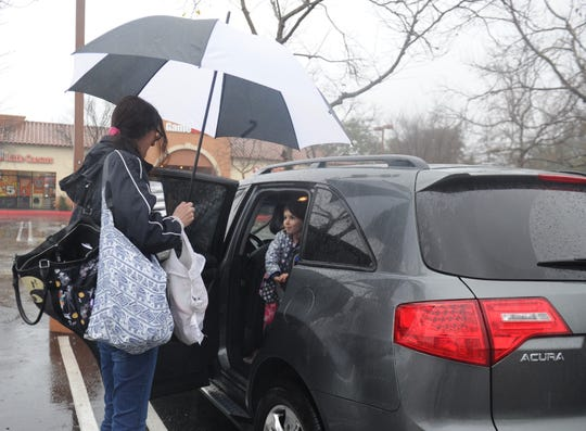 STAR FILE PHOTO Rain showers brought out umbrellas at a Thousand Oaks grocery store last month.