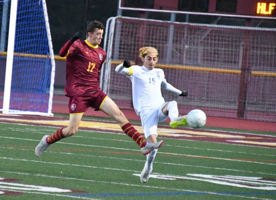 Simi Valley striker Alec Silva, left, chases down Alta Loma's Juan Carlos Rodriguez on Wednesday night in the CIF-Southern Section Division 2 quarterfinals at Simi Valley High. Alta Loma won, 1-0.