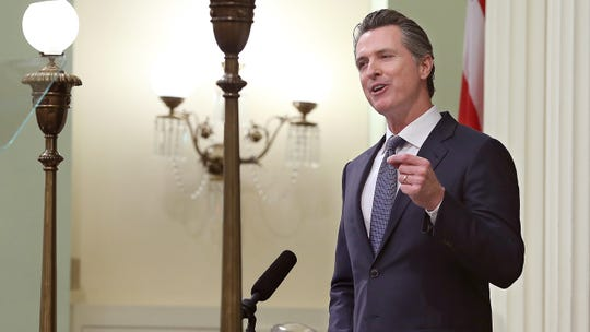 In this photo taken Tuesday, Gov. Gavin Newsom delivers his first State of the State address to a joint session of the Legislature at the Capitol in Sacramento.
