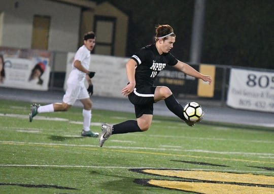 Newbury Park striker Luke Mitchell leaps to control the ball during Wednesday night's CIF-Southern Section Division 2 quarterfinal at Newbury Park High. Riverside Poly advanced on penalty kicks after a 2-2 tie.