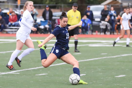 Redwood's Jill Nelsen prepares to score the first goal against Arroyo Grande during a Central Section Division I High School girls soccer playoff game on Feb. 13, 2019.