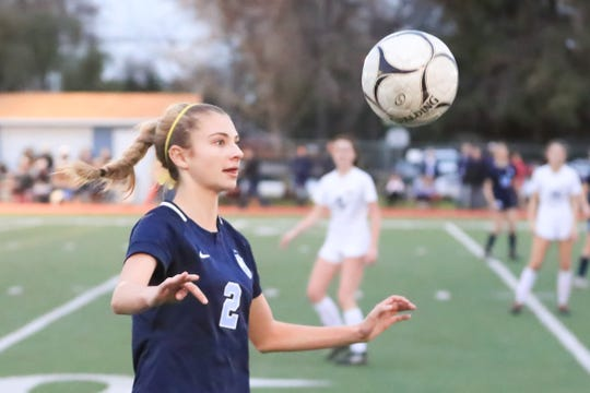 Redwood's Evan House plays versus Arroyo Grande in a Central Section Division I High School girls soccer playoff game on Feb. 13, 2019.