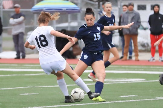 Redwood's Jill Nelsen (15) battles for the ball against Arroyo Grande's (18) Jiana Martin during a Central Section Division I High School girls soccer playoff game on Feb 13th 2019.