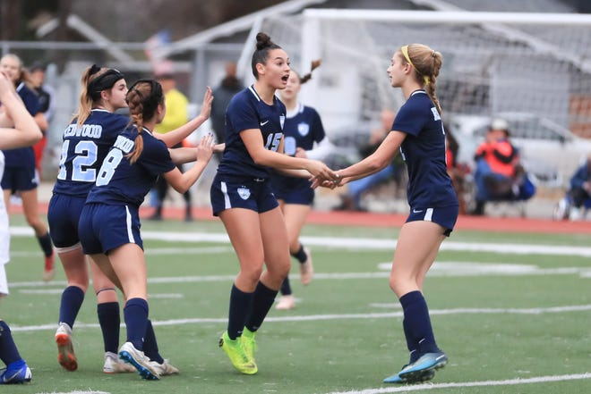 Redwood celebrates their first goal against Arroyo Grande during a Central Section Division I High School girls soccer playoff game on Feb 13th 2019.