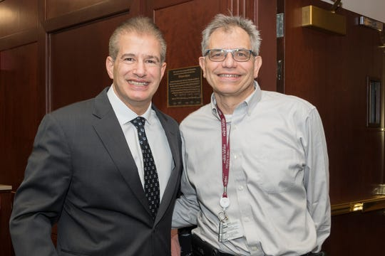 Steven Benvenisti, with Dr. Glenn Seliger, who treated him 30 years ago at Helen Hayes Hospital. Benvenisti brought in a free Valentine's Day lunch for some 400 staff members on Feb. 14, 2019.