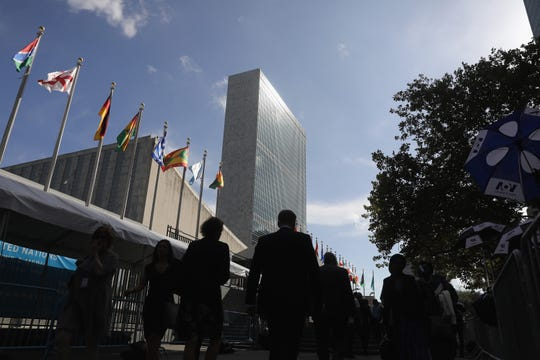 NEW YORK, NY - SEPTEMBER 26:  People walk past the United Nations headquarters on September 26, 2018 in New York City. World leaders gathered for the 73rd annual meeting at the UN headquarters in Manhattan.  (Photo by John Moore/Getty Images)