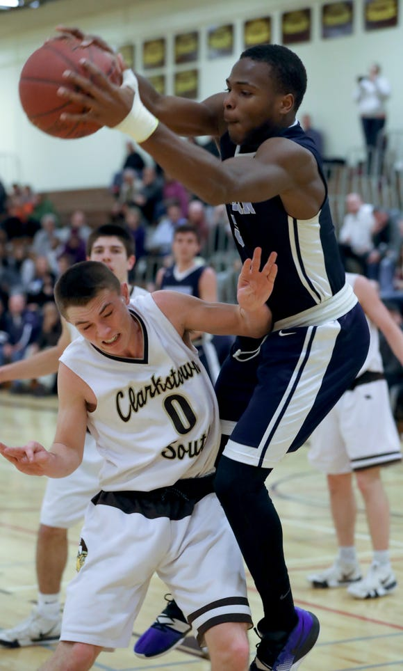 Suffern's Clevmer Lubin grabs a rebound over Clarkstown South's Jack Tucek during their game at Clarkstown South Feb.13, 2019. Suffern won 46-20.