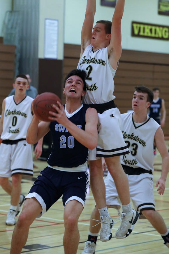 Suffern's Will Krebs drives to the net under Clarkstown South's Tony Hastings during their game at Clarkstown South Feb.13, 2019. Suffern won 46-20.
