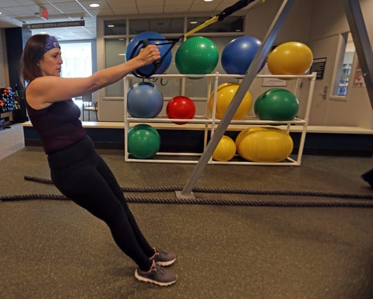 Elisabeth Kepley works out at Sarner Health and Fitness at  Stamford Health's Tully Health Center in Stamford, Conn., Feb. 14, 2019. The heart Elisabeth Kepley was born with was damaged by chemo. In 2017, she got a new heart, courtesy of a 30-year-old New Rochelle native who had fallen on a worksite.