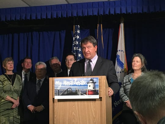 Westchester County Executive George Latimer speaks to reporters in the press briefing room at his office on Feb. 14, 2019. Behind him are representatives of local municipalities supporting a 1 percent local sales tax increase.