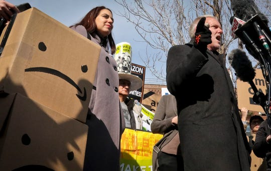New York City Councilman Jimmy Van Bramer, right, speaks during a press conference in Gordon Triangle Park in the Queens borough of New York following Amazon's announcement it would abandon its proposed headquarters for the area, Thursday Feb. 14, 2019.