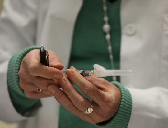 Rockland Department of Health nurse Bonnie Sullivan, RN prepares a flu shot to give to a patient during a free clinic for residents at the Martin Luther King Multi-Purpose Center in Spring Valley Feb. 13, 2019.
