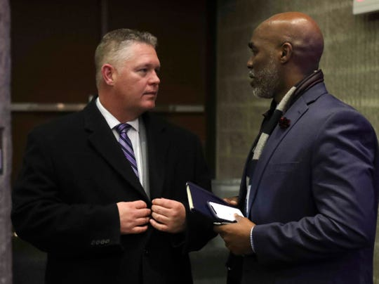 Superintendent candidates Hugh Broomall (left) and Dorrell Green greet each other after Green was voted as the 5-2 choice for next superintendent of the Red Clay school board Wednesday.