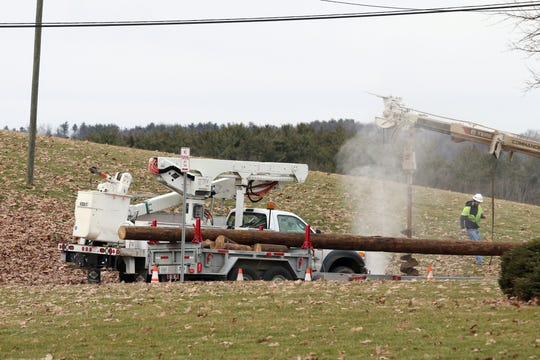 A utility crew struck a gas line on Blue Avenue while replacing a pole Thursday afternoon.