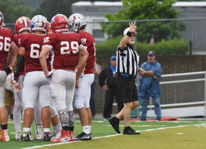 Umpire Gene Bess signals third down during the Muskingum County-Licking Valley All-Star Game in 2017. Bess will be one of 14 state officials inducted into the Ohio High School Athletic Association Officials Hall of Fame in June.