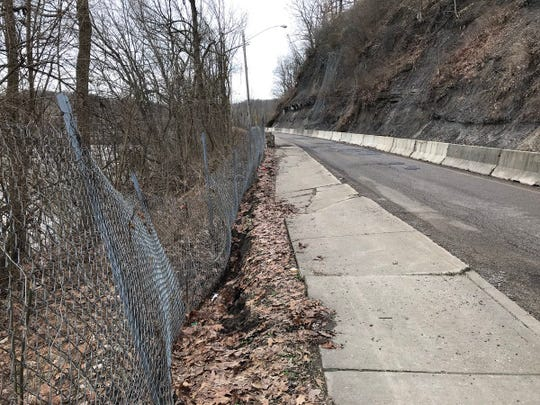 Muskingum Avenue, more commonly known as Dug Road, was closed Thursday afternoon between Pine Street and the railroad tracks after part of the shoulder has slipped.