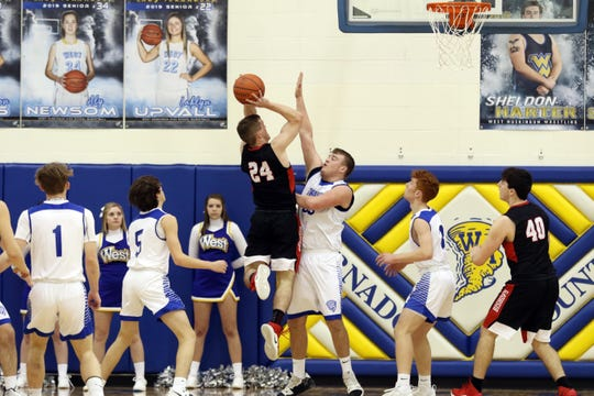 Rosecrans' Weston Nern puts up a shot under pressure from West Muskingum's Hunter Fox.