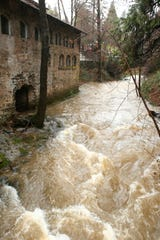 Wolf Creek water flows past the Northstar Mining Museum's power house, Wednesday, Feb. 13, 2019, in Grass Valley, Calif.
