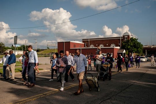 A march from Tulsa's Greenwood district to Reconciliation Park on May 31, 2018, marks the 97th anniversary of the racist violence that devastated the thriving area once known as 'Black Wall Street.'