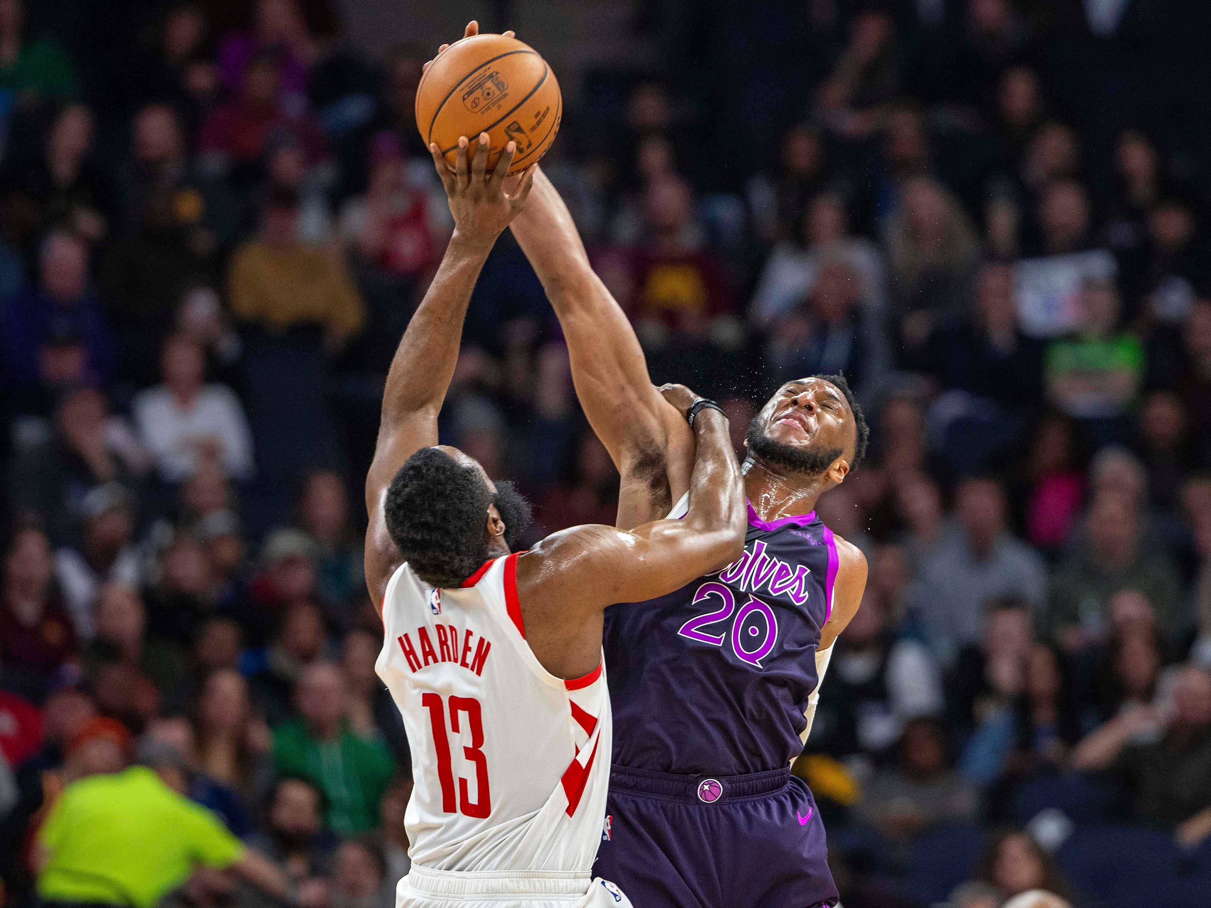 Feb. 13: T'wolves guard Josh Okogie (20) blocks Rockets guard James Harden (13) on a 3-point attempt during the second half in Minneapolis.