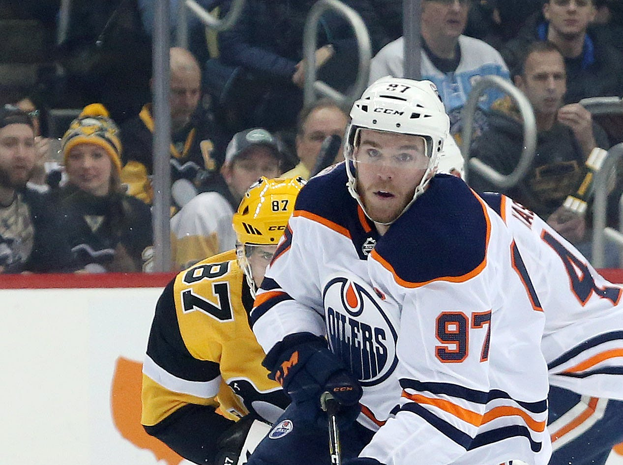 Feb. 13: Edmonton Oilers center Connor McDavid moves the puck up ice ahead of Pittsburgh Penguins center Sidney Crosby. Each had an assist in the game, which was won by the Penguins 3-1.
