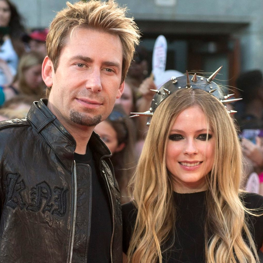 Chad Kroeger and Avril Lavigne pose on the red carpet during the 2013 MuchMusic Video Awards in Toronto on Sunday, June 16, 2013. (AP Photo/The Canadian Press, Nathan Denette) ORG XMIT: FNG125