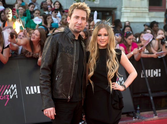 Chad Kroeger, left, and Avril Lavigne ended their two-year marriage in 2015 but have remained good friends.