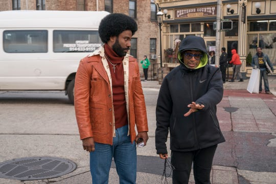 """Designer Marci Rodgers thrifted some of the '70s costumes for """"BlacKkKlansman,"""" directed by Spike Lee (right) and starring John David Washington (left)."""