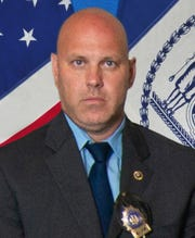 In this undated photo provided by the New York City Police Department, Det. Brian Simonsen is shown. Simonsen was shot and killed by friendly fire Tuesday night.