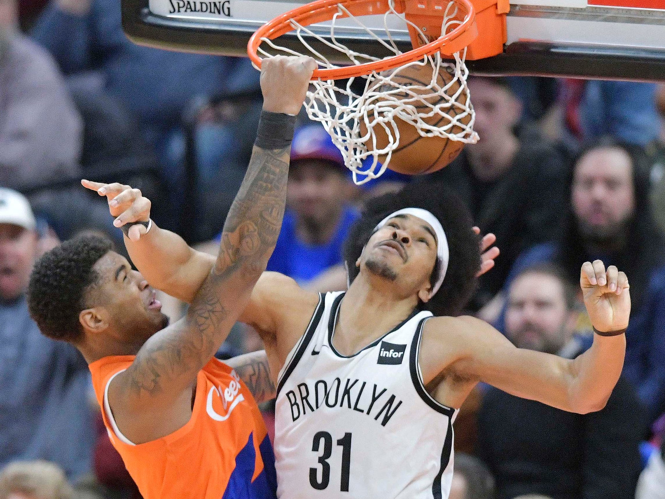 Feb. 13: Cavaliers forward Marquese Chriss (3) finishes the thunderous one-handed slam over Nets center Jarrett Allen (31) in Cleveland.
