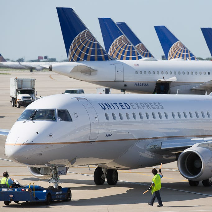 A United Express Embraer E170/75 is pushed back for departure from Chicago O'Hare International Airport in June 2015.